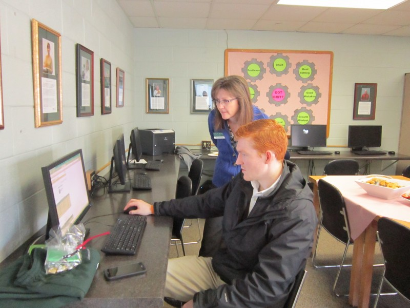 Kelley Beckwith assists a student.