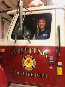 Danielle Morse sits in a fire truck